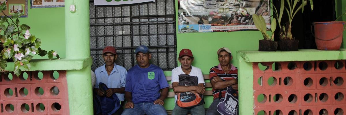 Men sit in front of office of accompanied defender Coban Guatemala
