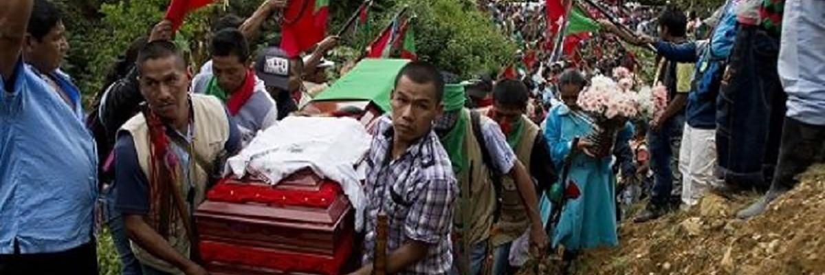 Hundreds of Indigenous people accompany the coffin of Daniel Coicue, a member of the Indigenous Nasa tribe